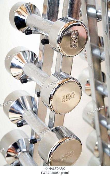 Silver dumbbells on rack