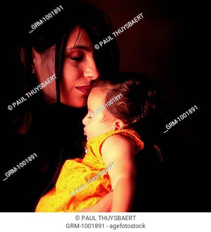 Arab mother holding her baby girl