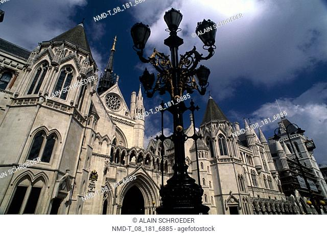 Low angle view of a lamppost in front of a building, Royal Courts Of Justice, London, England