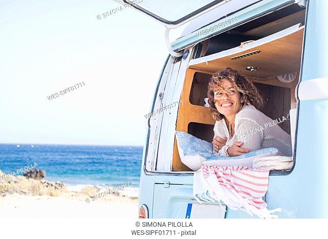 Spain, Tenerife, portrait of happy woman in van