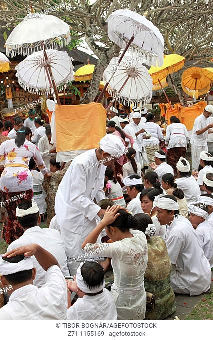 Indonesia, Bali, Mas, temple festival, people, odalan, Kuningan holiday, priest giving blessings