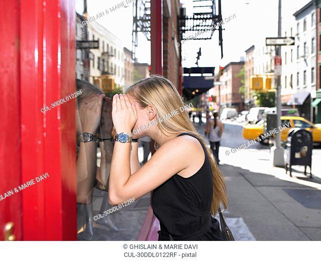 Woman looking through a shop window