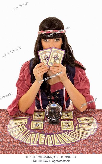 fortuneteller with crystal ball and tarot cards