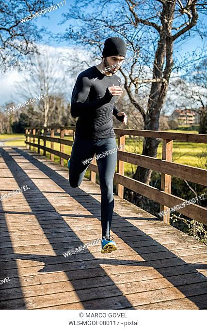 Spain, Gijon, athlete running in park