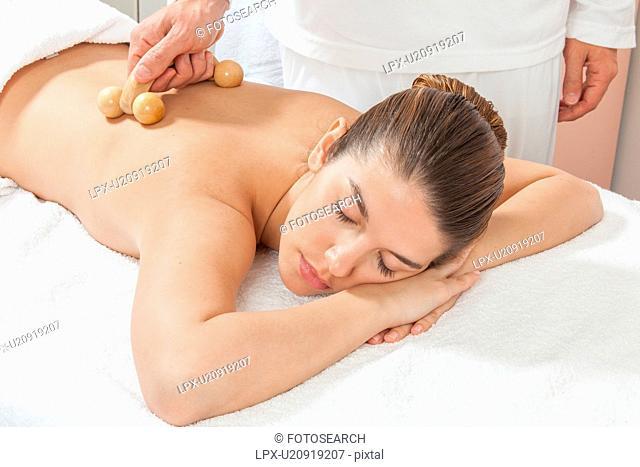 Woman lying gets great massage