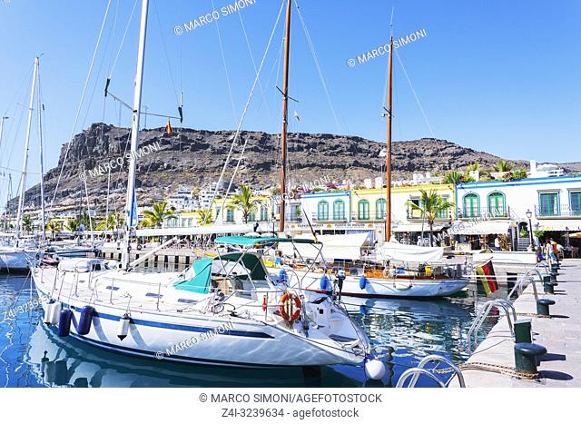 Sail boats moored by waterfront, Puerto de Mogan, Gran Canaria, Canary Islands, Spain