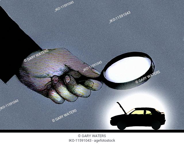 Hand holding magnifying glass over car with open bonnet