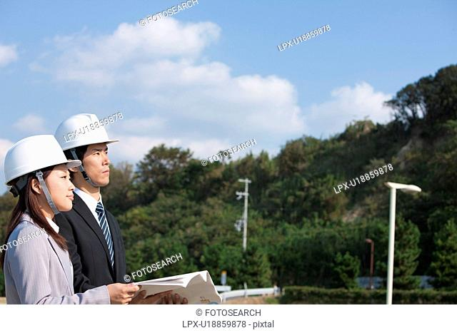 Two Businesspeople at Construction Site