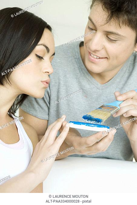 Couple looking at paint color