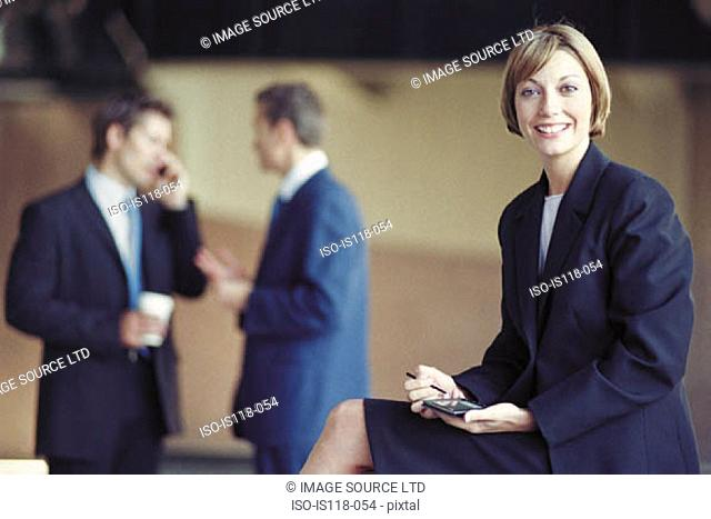 Businesspeople outside office