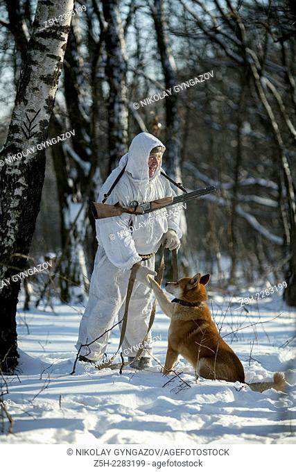 Hunting winter fishing with dog