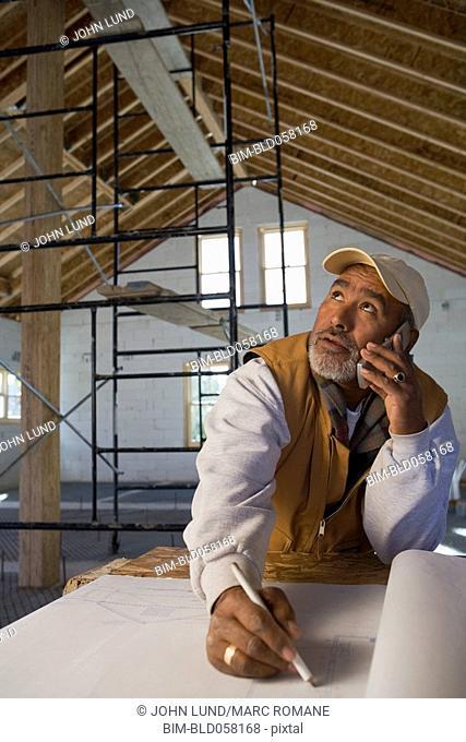 Hispanic architect talking on cell phone