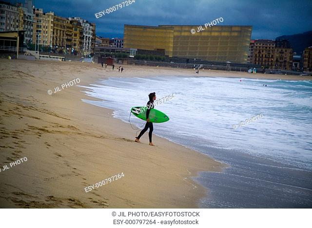Surfer with his board, walking towards the sea  Zurriola Beach  Donostia  San Sebastian  Gipuzkoa  Spain