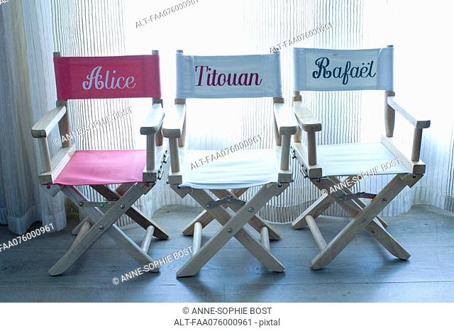 Director's chairs with names embroidered on them