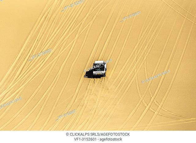 Offroad vehicle driving on the sand dunes,Sandwich Harbour, Namib Naukluft National Park,Namibia,Africa