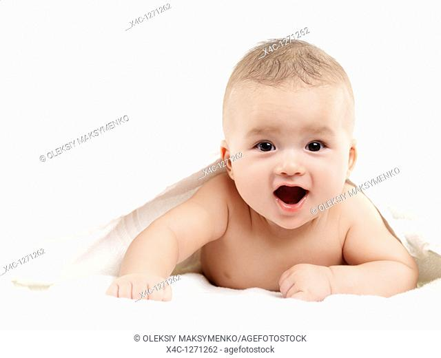 Portrait of a four month old baby boy with a joyous expression on his face looking at the camera  Isolated on white background