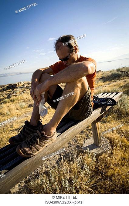 Male trail runner taking a break the Lakeside Trail, Antelope Island State Park, Utah, USA