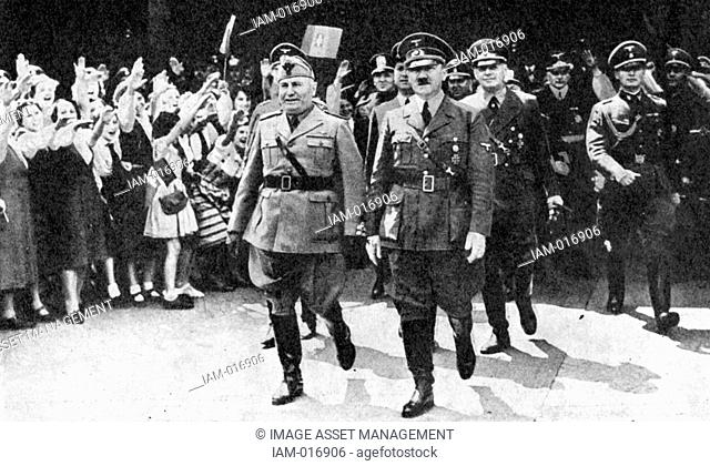Adoph Hitler and Benito Mussolini in Munich, 18 June 1940, to discuss terms for an armistice with France. Behind them are their Foreign Ministers Galeazzo Ciano...