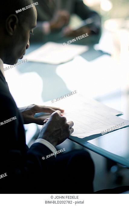 Black businessman reading notes