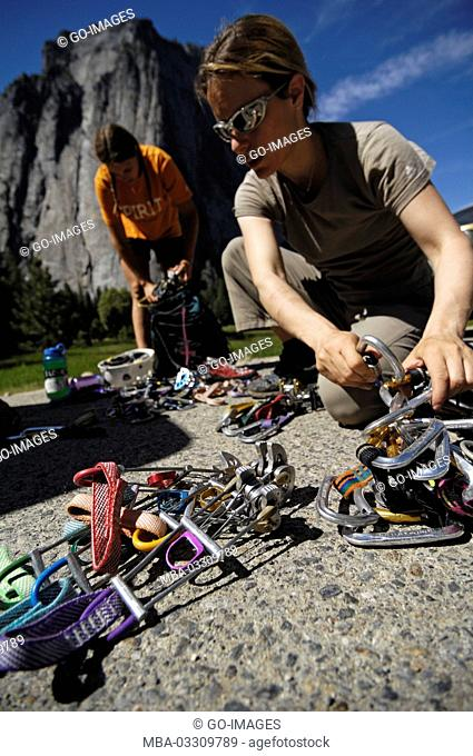 Women sort climbing equipment, Yosemite national park