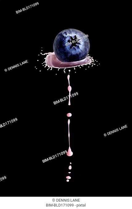 Splashing liquid on blueberry