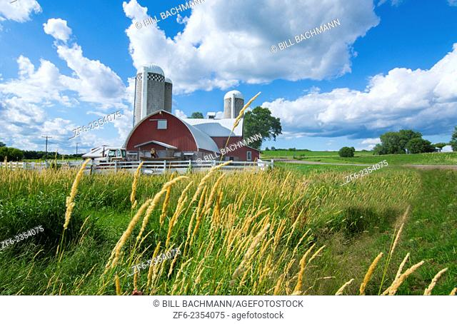 Eau Claire Wisconsin farm and red barn in picturesque scene of farming outside the country green plants and clouds