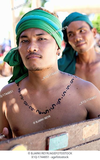 The warriors of Lapu-Lapu, a native chieftain of Mactan Island, getting ready for the battle at the Battle of Mactan reenactment or Kadaugan Festival  The...
