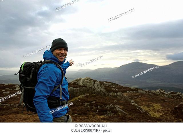 Hiking man admiring mountain view