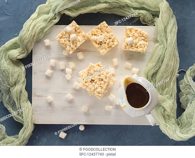 Puffed rice and marshmallow bars with caramel sauce. Top view