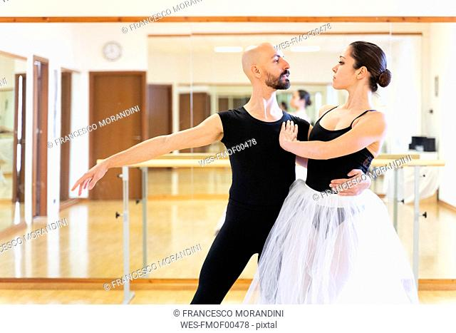 Couple dancing in ballet studio