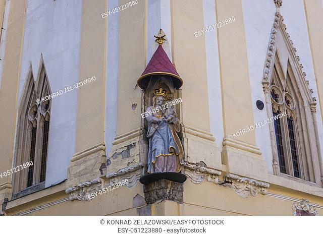 Figure of Our Lady with baby jesus on the tower of Old Town Hall buildings complex from 14th century on the Old Town in Bratislava, Slovakia