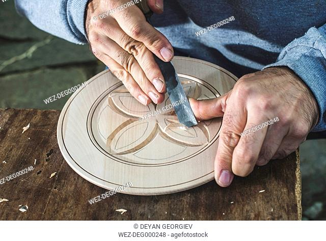 Woodcarver making threaded plate