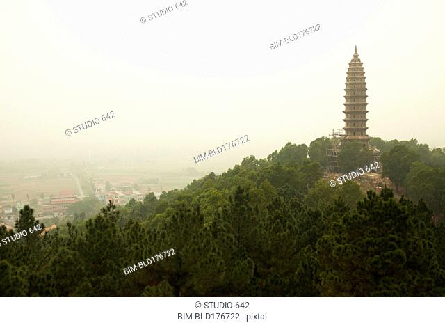 Buddhist temple tower on hilltop in remote landscape