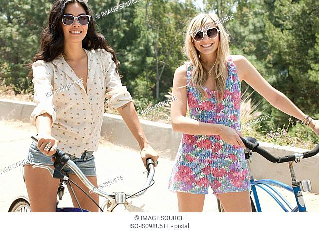 Two young women with bicycles on vacation