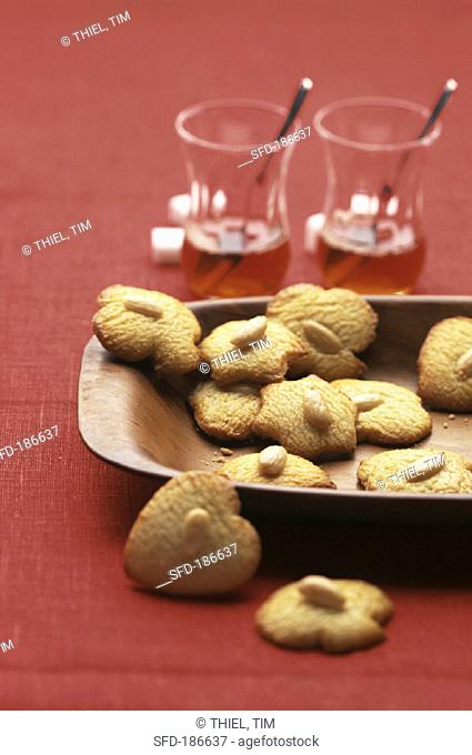 Almond biscuits against red background