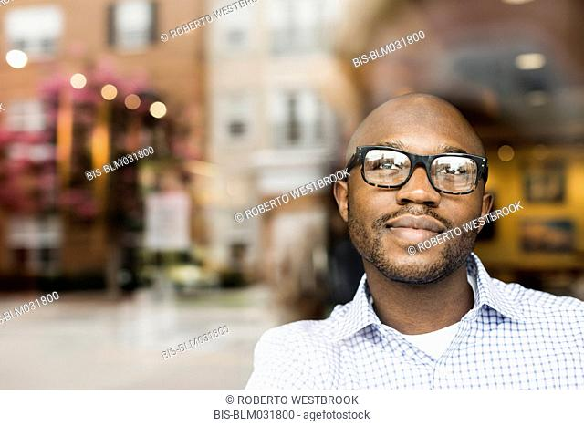Black man looking out window