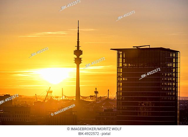 Olympic grounds with Olympic Tower and Olympic Stadium at sunset, in front of Skyline Tower, Munich, Upper Bavaria, Bavaria, Germany, Europe