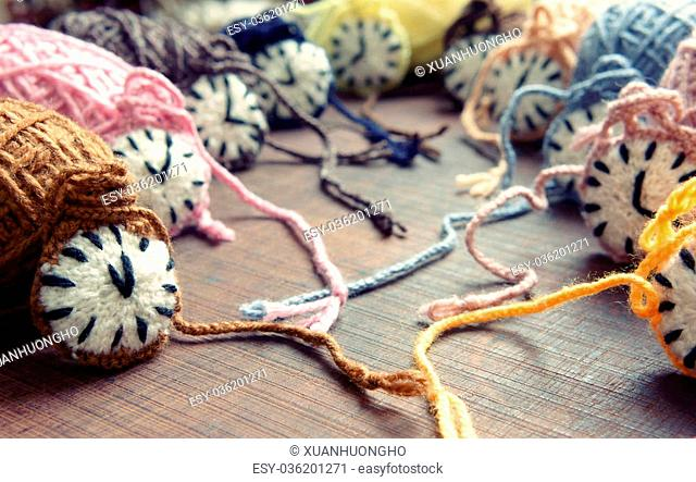 Amazing knitted clock, group of colorful watch make from yarn to happy new year, wonderful idea for handmade hobby, in warm color, abstract art