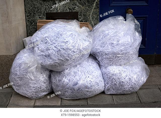 bags of shredded paper documents sitting outside an office belfast northern ireland uk united kingdom