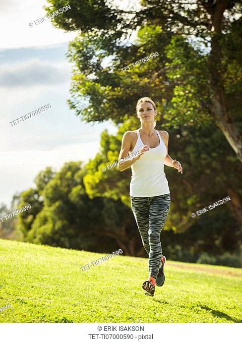 Woman running through lawn