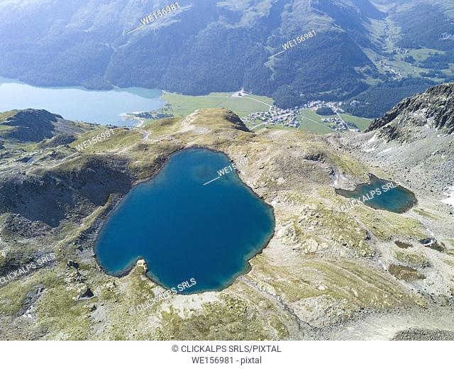 Aerial view of the blue water of Lej da la Tscheppa, St. Moritz, Engadine, canton of Graubünden, Switzerland, Europe