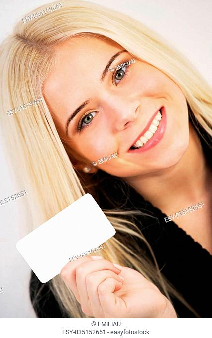 Woman holding a blank gift card