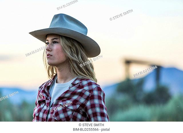 Caucasian teenage girl wearing cowboy hat