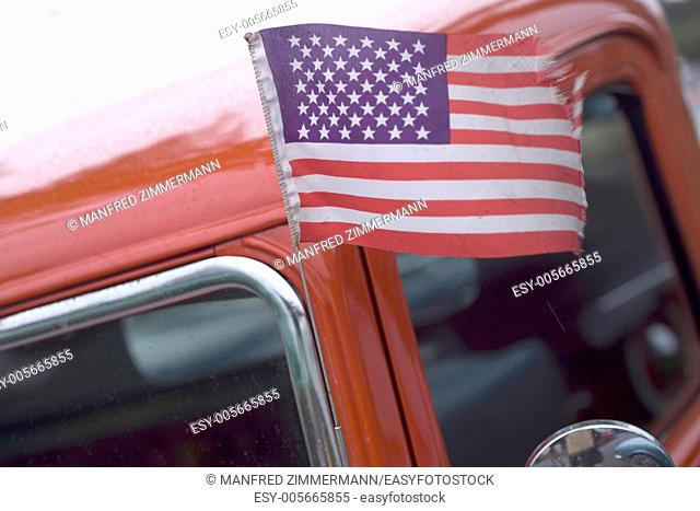 American flag blowing in the Ford