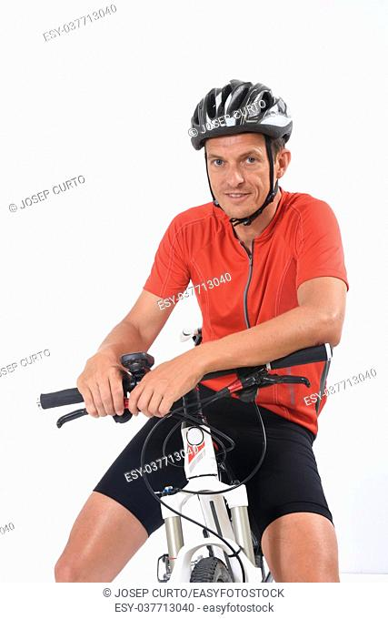 Portrait of a cyclist with mountain bike