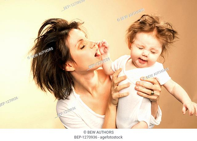 Woman with baby after waking up