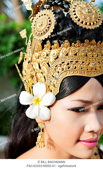 Cambodia, Siem Reap, Close up of young woman wearing traditional dancer attire