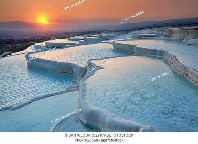 Pamukkale, the limestone terraces, view at sunset time, Pamukkale near Denizli, Turkey