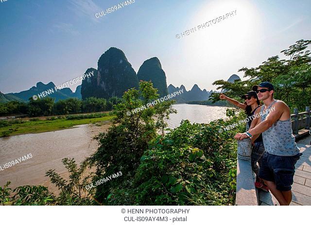 Couple admiring Li Jiang river, Guangxi, China