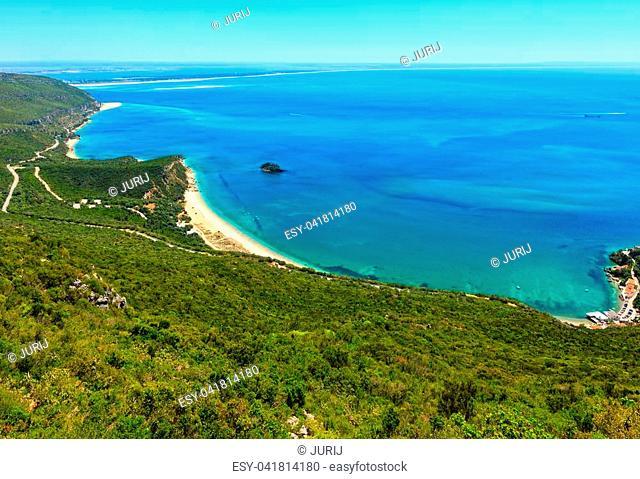 Summer sea coastal landscape with sandy Portinho beach. Top view from Nature Park of Arrabida in Setubal, Portugal